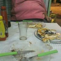 Photo taken at Pizzaria D'Carlos by Ruben B. on 9/25/2012