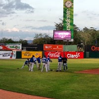 Photo taken at Estadio Julian Javier by Milca P. on 1/18/2014