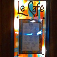 Photo taken at Le Café by Dee S. on 8/5/2014