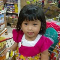 Photo taken at Top 100 Supermarket by Nella Eka S. on 12/31/2013