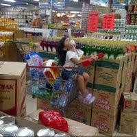 Photo taken at Top 100 Supermarket by Nella Eka S. on 6/19/2014