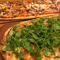 Photo taken at Earth Pizza by Justin B. on 1/11/2017