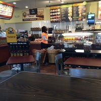 Photo taken at Einstein Bros Bagels by John M. on 5/17/2014