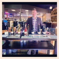Photo taken at Pogo's Wine & Spirits by Andy B. on 9/15/2012
