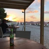 Photo taken at Madeariman Beach Bar by Karen A. on 1/1/2017