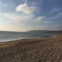 Photo taken at Charmouth Beach by Jake A. on 11/26/2016