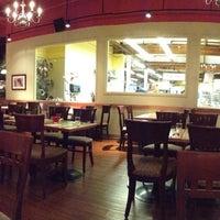 Photo taken at Pomegranate Bistro by Edward U. on 11/10/2012