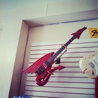 Photo taken at Guitar and Bass Land by Jolie N. on 7/26/2014