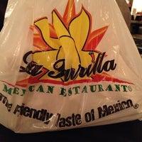 Photo taken at La Parrilla by Miranda J. on 11/25/2012