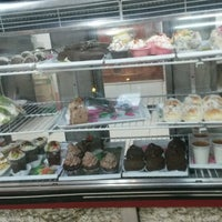 Photo taken at Panaderia & Confiteria Oliveira by Ruth R. on 1/16/2015