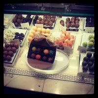 Photo taken at Godiva Chocolatier by Dwayne K. on 5/17/2013