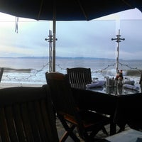 Photo taken at Boathouse at Hendry's Beach by Rachel K. on 12/14/2012