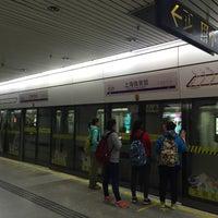 Photo taken at Shanghai Indoor Stadium Metro Stn. by Shunitsu M. on 3/19/2016