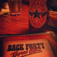 Photo taken at Back Forty Texas BBQ Roadhouse & Saloon by Nicole I. on 7/27/2013