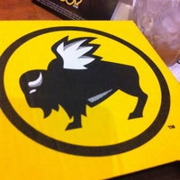 Photo taken at Buffalo Wild Wings by Fiona B. on 3/8/2013