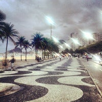 Photo taken at Copacabana Beach by Angelo A. on 7/16/2013
