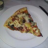 Photo taken at Gratzzi Italian Grille by James M. on 2/5/2013
