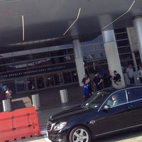 Photo taken at Gate 69B by Marie P. on 11/3/2013