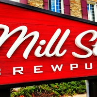 Photo taken at Mill St. Brew Pub by Ross B. on 2/12/2013