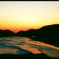 Photo taken at Praia de Grumari by Richard A. on 9/26/2012