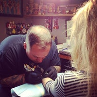 Photo taken at Three Kings Tattoo Parlor by Romain P. on 4/23/2013