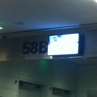 Photo taken at Gate 58B by Jimmy A. on 12/7/2012