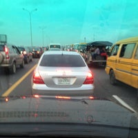 Photo taken at Third Mainland Bridge by Lawrence S. on 7/5/2013