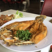 Photo taken at Ruangrit Seafood by chom p. on 3/25/2017