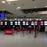 Photo taken at Belfast International Airport (BFS) by Ashley H. on 12/31/2012