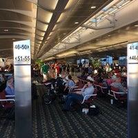 Photo taken at Gate 129 by Jim F. on 2/10/2014
