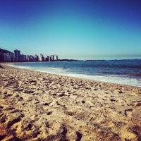 Photo taken at Praia da Costa by Letícia G. on 6/30/2013