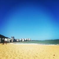 Photo taken at Praia da Costa by Letícia G. on 10/26/2012