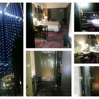 Photo taken at La Perle International Hotel by Onesix Eightcomm S. on 6/8/2013