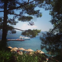 Photo taken at Marmaris Park Beach by Vika K. on 7/23/2013