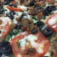 Photo taken at Kaimuki's Boston Style Pizza by Tina I. on 5/7/2016