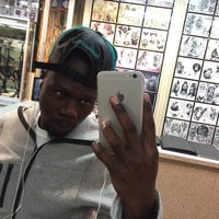Photo taken at West 4 Tattoo by Marquavius E. on 10/4/2015