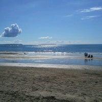 Photo taken at Mairangi Bay Beach by Simon B. on 4/6/2013