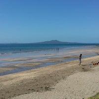 Photo taken at Mairangi Bay Beach by Simon B. on 10/19/2013