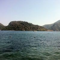 Photo taken at Marmaris Park Beach by Burak I. on 8/25/2013