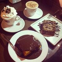 Photo taken at Café Raiz by Renata N. on 5/19/2014