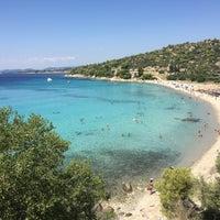 Photo taken at Koviou Beach by Ayhan Y. on 8/25/2017