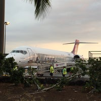 Photo taken at Gate 10 by Adrian L. on 12/12/2014