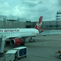 Photo taken at Gate 13 by Adrian L. on 9/9/2015