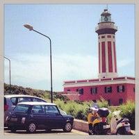 Photo taken at Faro di Punta Carena by Владимир on 6/29/2013