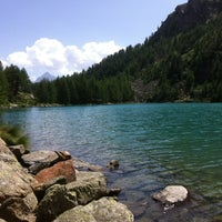Photo taken at Lago Lagazzuolo by Andrea Z. on 8/5/2013