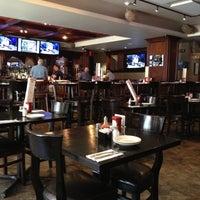 Photo taken at Biggie's Restaurant, Raw Bar, and Tavern by Dan I. on 4/30/2013