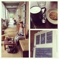 Photo taken at Karma Coffee by Karoline L. on 9/4/2013