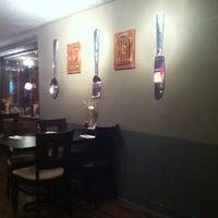 Photo taken at Zen Japanese Thai Cuisine by Ashleigh T. on 12/23/2012