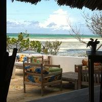 Photo taken at The Rock Restaurant Zanzibar by Mickey M. on 3/5/2013