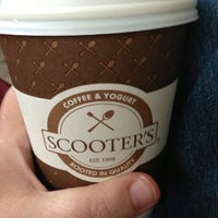 Photo taken at Scooter's Coffeeehouse by Jill C. on 6/10/2013